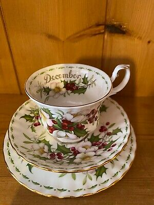 December teacup, saucer & plate set by Royal Albert Flower of the Month series