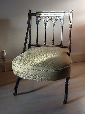 Aesthetic movement Egyptian revival conversation chair -William Walker