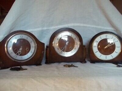 three vintage mantle clocks