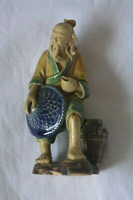 Vintage Chinese mudman figurine walking with blue hat. 95 mm. No chips or cracks
