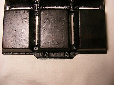 >  Griswold No.14 Muffin Pan , it has cooking buildup , no cracks , cast iron