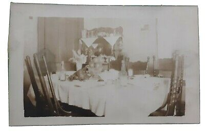 Rppc photograph real evidence of ghost? Ghost lady caught in mirror postcard.