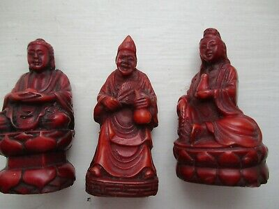 Three small Chinese carved seated vintage figurines - reddish-brown