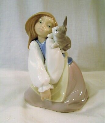 LLADRO/Nao Pretty young  Girl with a rabbit on her shoulder