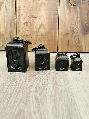 4 X Antique Cast Iron Weights With Ring Handles