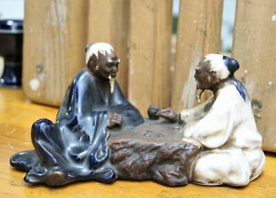 Two old men play chess Vintage Chinese Porcelain Glazed Statue