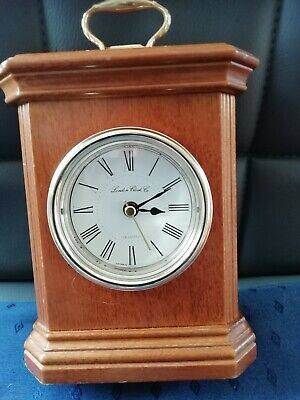 (1589) LIGHT BROWN WOODEN CARRIAGE/MANTEL PEICE CLOCK MADE BY LONDON CLOCK Co QU