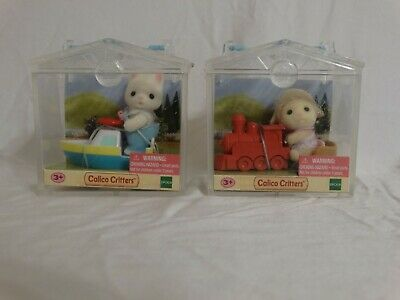 Calico Critters Baby Lamb Figure with Red Train in Clear Display Case BRAND NEW
