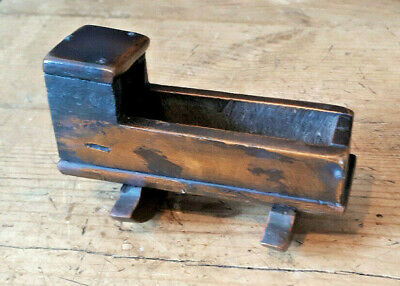 A charming little 18th/early 19th century fruitwood miniature doll's cradle.