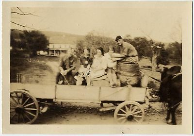 Group In Antique Wagon W/ Wooden Wheels Photo