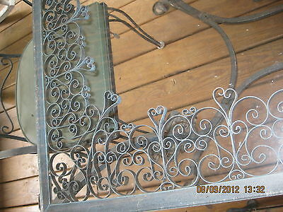 Antique glass top wrought iron table and chairs