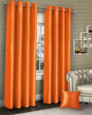 Pair Of Stylish Ring Top Eyelet Lined Curtains Plain Faux Silk Orange Colour