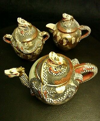 SATSUMA  DRAGON. Teapot set pre 1920 thousand faces with deities scene