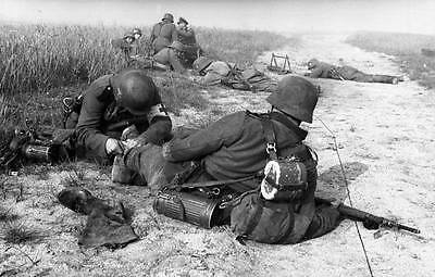 WWII Photo Wounded German Under Fire Medic  WW2 / 2103