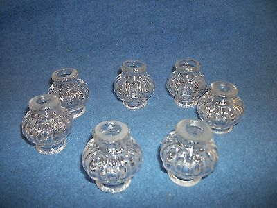 Set Of Seven Molded Glass Beads