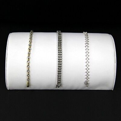 Bracelet Display In A Half Moon Style White Faux Leather