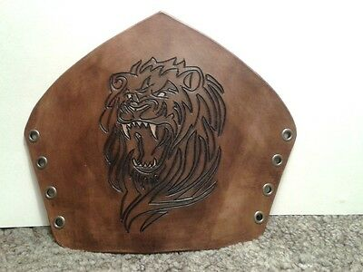 Hand-made carved leather bracers with lion head, antique brown finish