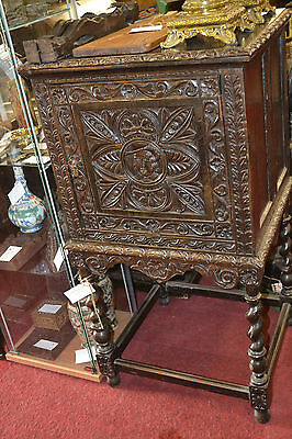 Early 19th century ebonised highly carved gothic style cabinet on stand, c1820