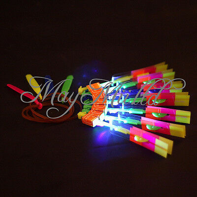 1/12 Flying Rotating Rocket Helicopter Flash LED Light Toy Fun Elastic Gift N