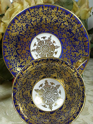 AYNSLEY COBALT CUP AND SAUCER HEAVY GOLD GILT STUNNING