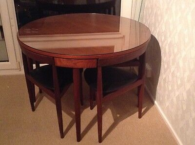 Stunning original teak Frem Rojle table with glass top and 4 chairs.