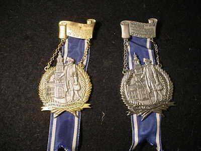 TWO (2) AM. WANDERING CLUB METALS AUGSBURG 1975 GOLD AND SILVER
