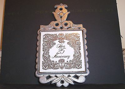 Vintage Silver Anniversary cast iron and tile trivet pot holder with rubber feet