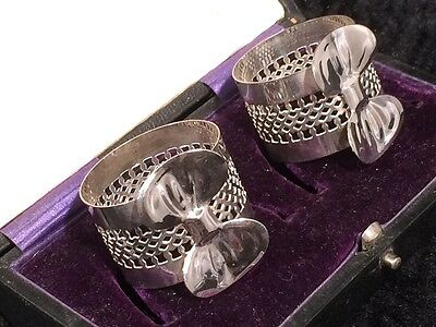 Antique EPNS Napkin rings in presentation case. Perforated decoration with bows.