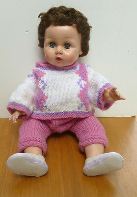 """Used19"""" Vinyl drink wet doll. Clothing not original. She has on a pink & white"""