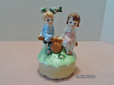 VINTAGE LEFTON MUSIC BOX, BOY AND A GIRL ON A TEETER TOTTER FIGURINE PORCELAIN