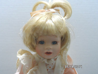 VINTAGE PORCELAIN BABY GIRL DOLL BLOND HAIR DRESSED IN PINK AND WHITE DRESS