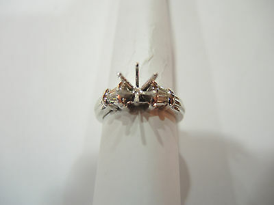 4=.16ct tw Diamonds Channel-Set in a Lady's Platinum Ring.