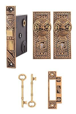Oriental solid bronze keyed mortise lock set with doorknobs and back plates