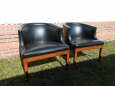 Pair of 70s Vintage Mid Century Black Faux Leather Barrel Club Chairs on Casters