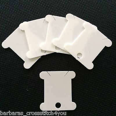 75 to 150 WHITE PLASTIC BOBBINS IDEAL FOR STORING CROSS STITCH THREADS