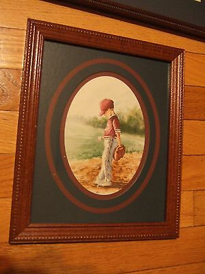 Home Interior picture of a boy playing baseball qith mitten and ball  (Reduced