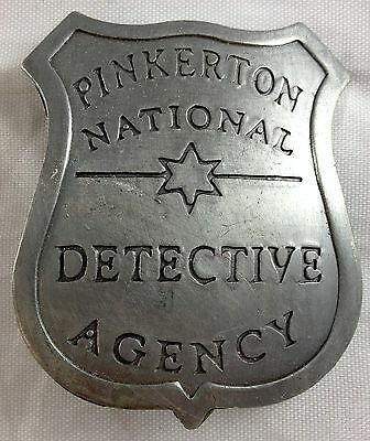 PINKERTON NATIONAL DETECTIVE AGENCY SHIELD SHAPED PRIVATE SECURITY GUARD BADGE