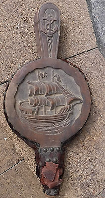 vintage bellow with sailing ship in wood