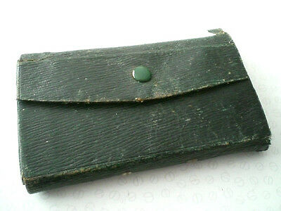 An Old Vintage Leather Fly Wallet With A Collection Of Old Hook Packets