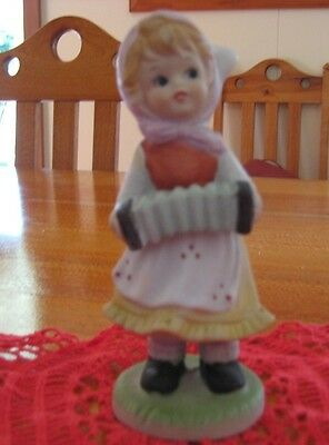 Collectable Vintage  Dutch Girl Playing A Squeeze Box