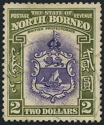 North Borneo SG 316 1939 $2 violet and olive-green. Used. Cat Value £180