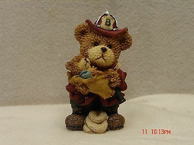 Firefighter Bear Figurine Carrying Baby