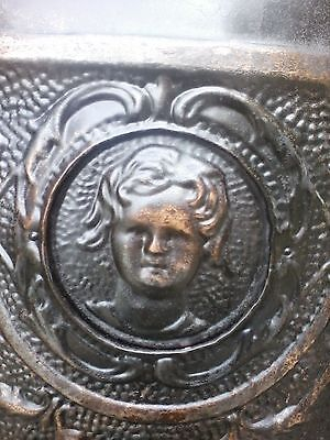Antique Embossed Tin Fireplace Cover Featuring Child's Face