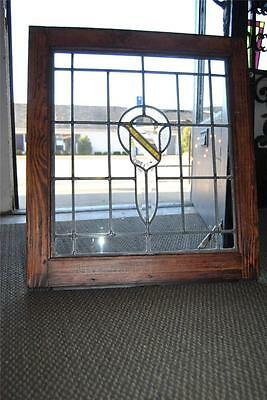 Antique Beveled Glass Window With Center Stained Shield