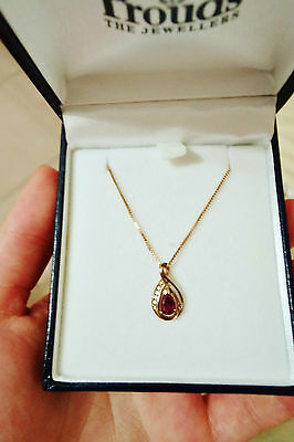 "9ct Gold Ruby Diamond Swirl Pendant from ""Prouds The Jeweller's""* Necklace"