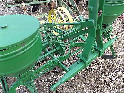 John Deere 247    2 row corn planter is a three point hitch Great for food plat!