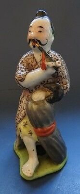 Chinese Porcelain Figure Of A Man Smoking A Pipe -  19Th Century