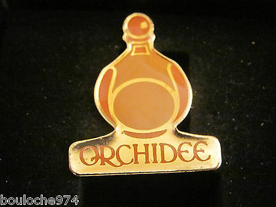 "Pin's /pins / Badge   Cosmétique Yves Rocher  "" Orchidee """