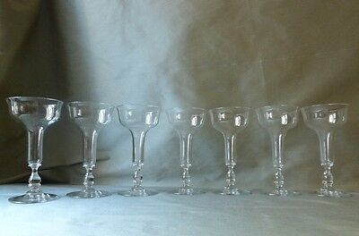 7 fine antique hollow stem champagne glasses, probably French, flawless, rare