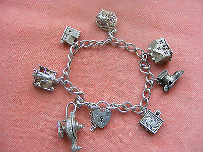 Nuvo Vintage Sterling Silver Charm Bracelet With 7 Nuvo Charms